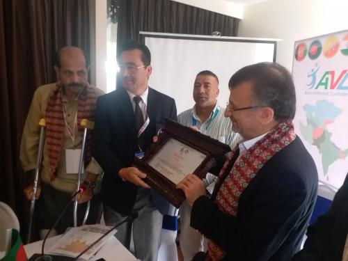 NVA General Secretary presenting Token of Love to Dr. Dawarzani