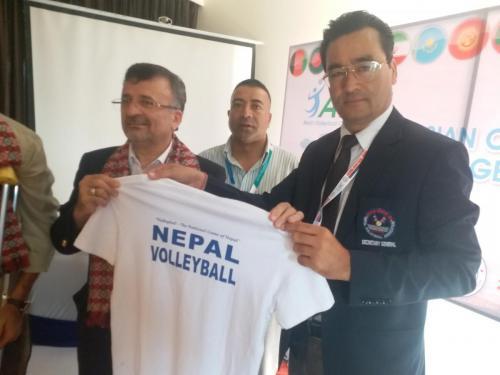NVA General Secretary presenting Tshirt to Dr. Dawarzani
